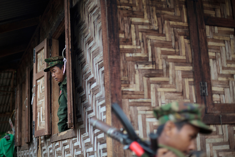 A KIA's soldier is seen in Rubber Hill Post a former Burmese post recover one month ago, Laja Yang village outskirts of Laiza, Kachin State, Myanmar on August 8, 2012. The KIA formed in 1961 in response to a military coup in Burma led by General Ne Win, who attempted to consolidate Burmese control over regions on the periphery of the state which were home to various ethnic groups. From 1961 until 1994, the KIA fought a grueling and inconclusive war against the Burmese junta. In 2011, general Sumlut Gun Maw confirmed renewed fighting in the state of Kachin for independence. One of the new reasons for the ending of the ceasefire is the creation of the Myitsone Dam which requires the submergence of dozens of villages in Kachin state.