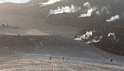 Volcanic eruption at Fimmvorduhals in Eyjafjallajokull. and people walking around the area in snowstorm. - Ferðamenn á göngu á Fimmvöruhálsi í kringum eldstöðvarnar