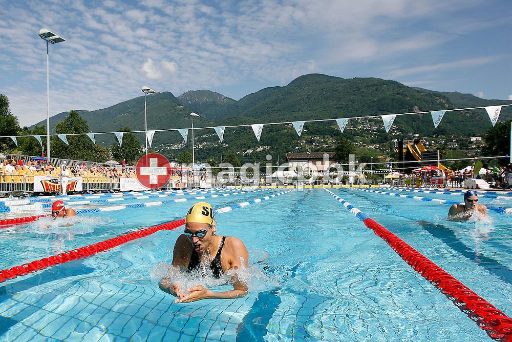 SCSH's Marina RIBI (C) and SCUW's Mia Baric (R) of Switzerland compete in the women's 200m breaststroke heats at the Swiss Swimming Summer Championships in Tenero, Switzerland, Sunday, July 5, 2009. (Photo by Patrick B. Kraemer / MAGICPBK)