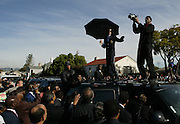 Pop star Michael Jackson stands on top of a car after his first court appearance at the Santa Barbara County Courthouse in Santa Maria, Calif. on January 16, 2004...Photo by Max Morse