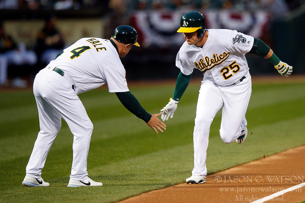 OAKLAND, CA - APRIL 04:  Ryon Healy #25 of the Oakland Athletics is congratulated by third base coach Chip Hale #4 after hitting a home run against the Los Angeles Angels of Anaheim during the first inning at the Oakland Coliseum on April 4, 2017 in Oakland, California. (Photo by Jason O. Watson/Getty Images) *** Local Caption *** Ryon Healy; Chip Hale
