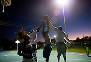 "Kelvin Preston (center), gets two hands on a rebound as he is flanked by Anqueon Baker (left) and Devey Fate (right), all of Stuart, as Devineir Mitchell, of Port St. Lucie, waits at left for a loose ball during a pick-up basketball game at the courts outside the 10th Street Recreation Center on Feb. 17, 2016, in East Stuart. Ryan Carter, who was also playing basketball, said he is a lifelong resident of East Stuart, where he was born and raised for 30 years. ""I've been coming out here since I was knee high,"" he said. ""A lot of times, most of the time, if there is any conflicts or anything, it's really from outside,"" Carter added. There had been no shootings to date in 2016, after the community saw a spike in gunfire in 2015. (XAVIER MASCAREÑAS/TREASURE COAST NEWSPAPERS)"