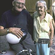 Elderly white couple living just above the poverty level - in back yard of home - Welaka, FL