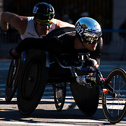 NYTRUN - NOV. 6, 2016 - NEW YORK - Marcel Hug (302), foreground, and Kurt Fearnley (303), who would go on to finish first and second respectively in the Pro Wheelchair Men division of the 2016 TCS New York City Marathon, are neck and neck as they cross into Central Park at 90th Street in Manhattan on Sunday morning. NYTCREDIT:  Karsten Moran for The New York Times