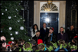The Prime Minister David Cameron Turns on the Downing Street Christmas lights with the x factor Finalist, Monday December 3, 2012. Photo by Andrew Parsons / i-Images