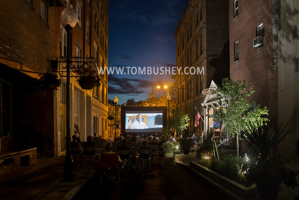 "Middletown, New York - People watch a free showing of Disney's ""McFarland USA"" on the King Street Walkway on Aug.18, 2016."