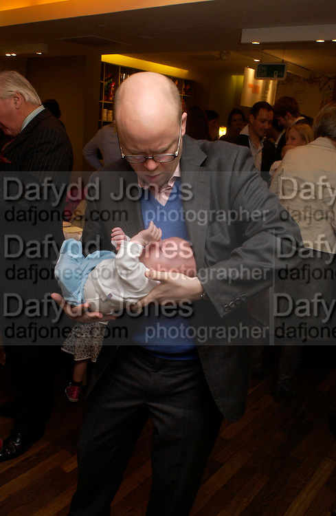 Toby Young and Ludo. Launch of 'Lucy  Sykes Baby, New York' Selfridges. 14 April 2005. ONE TIME USE ONLY - DO NOT ARCHIVE  © Copyright Photograph by Dafydd Jones 66 Stockwell Park Rd. London SW9 0DA Tel 020 7733 0108 www.dafjones.com