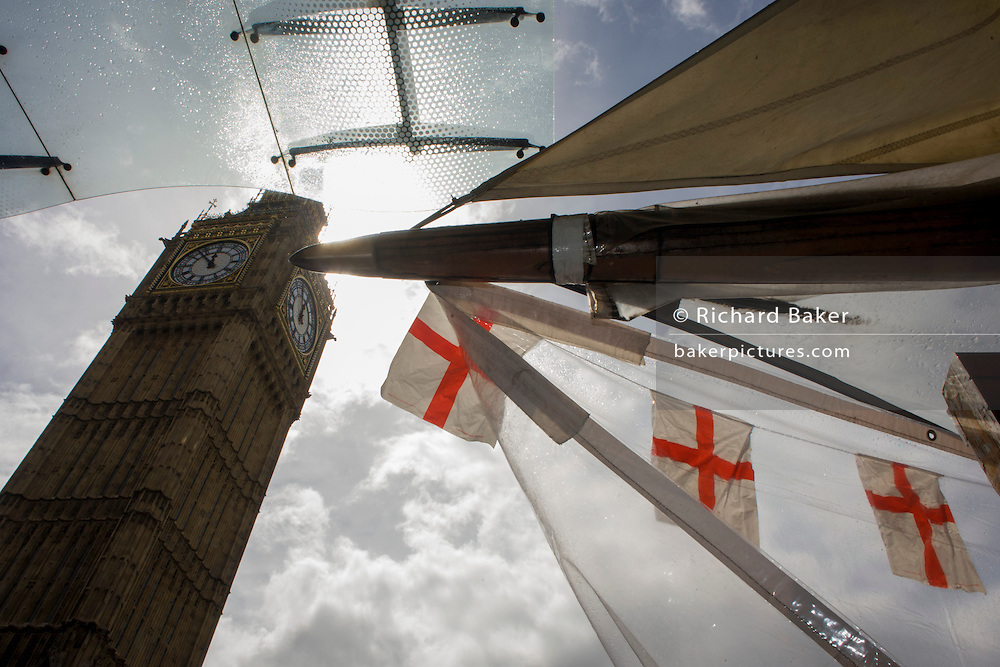 High winds and wet weather herald an uncertain week in the Britain less than 24 hours before the UK's general election. Unlikely prospects for a majority government by the end of the week means stormy deals between political parties and discontent with voters. English flags on a tourist kiosk hang below the Elizabeth Tower containing the bell known as Big Ben.