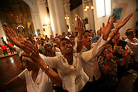 Women pray to Santa María la Antigua, the patron saint of Panama City, during a mass in the cathedral in the plaza of Panama City, Panama on Sunday, September 9, 2007. (Photo/Scott Dalton).