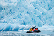 Guests from the National Geographic Sea Lion ride in small inflatable boats in front of South Sawyer Glacier in Tracy Arm, part of the Tracy Arm - Fords Terror Wilderness, Alaska.