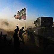 Humvees carrying injured soldiers of the Iraqi Army's Golden Division special forces unit arrive at theGogjali field clinic from fighting on the front lines in Mosul, Iraq.