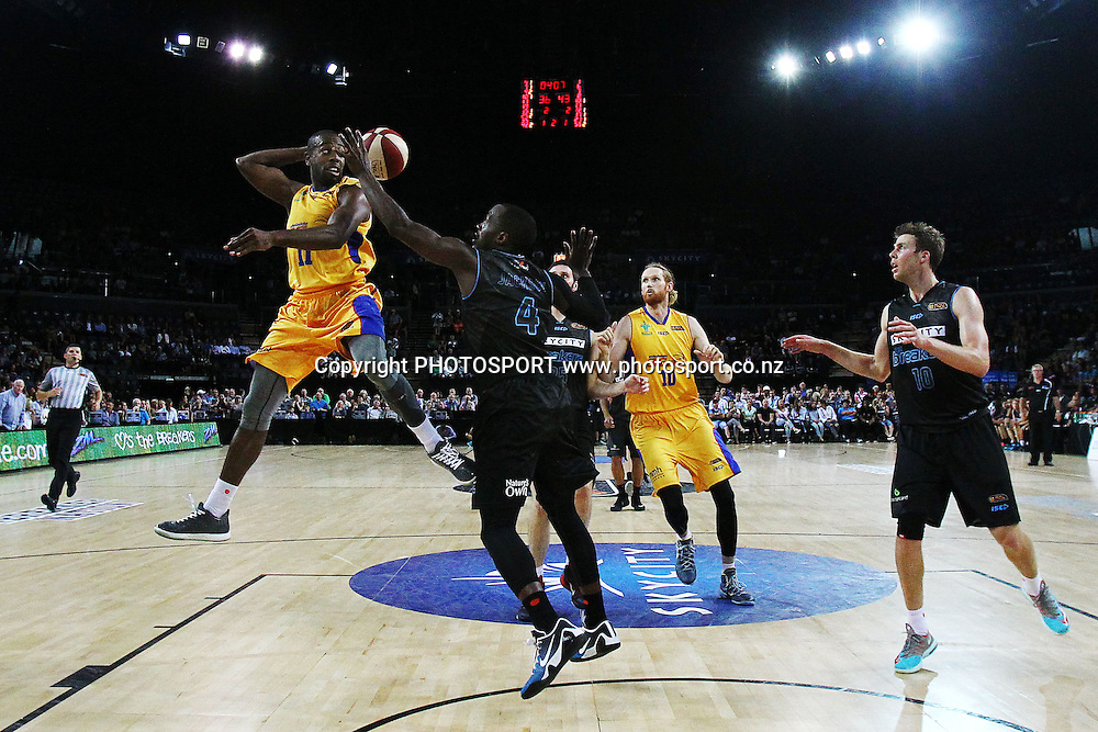 Jamar Wilson of the 36ers dishes a behind the head pass against Cedric Jackson of the Breakers. 2014/15 ANBL, SkyCity Breakers vs Adelaide 36ers, Vector Arena, Auckland, New Zealand. Thursday 12 February 2015. Photo: Anthony Au-Yeung / www.photosport.co.nz