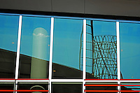 Talley Student Union tower reflected windows along Stafford Commons.