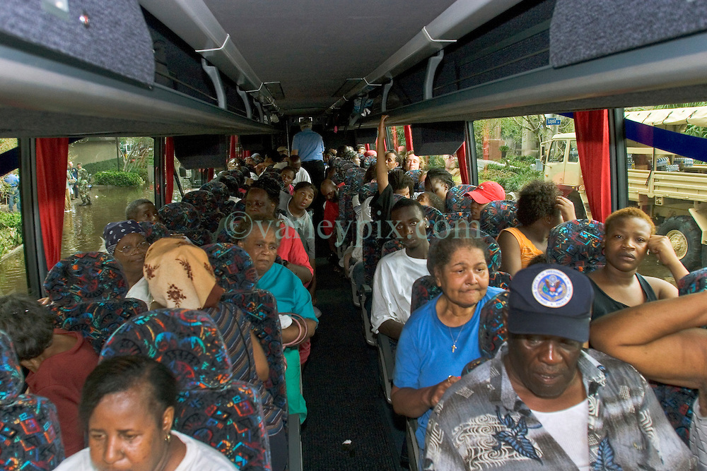 01 Sept, 2005. New Orleans, Louisiana.<br /> Louisiana. Mass evacuation begins. Passengers on the first bus to leave the Superdome at Poydras place in New Orleans.<br /> Photo©; Charlie Varley/varleypix.com