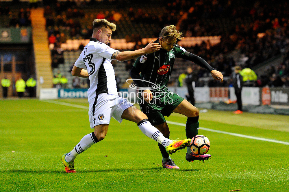 Jack Jebb of (33) Newport County fouls Oscar Threlkeld (18) of Plymouth Argyle during the The FA Cup match between Plymouth Argyle and Newport County at Home Park, Plymouth, England on 3 December 2016. Photo by Graham Hunt.