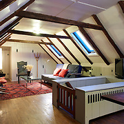 GLEN MILLS, PA - JANUARY 7, 2016: The original attic with exposed timber framing has been converted to a sitting room. Heat rises to warm up the room which is perfect for naps. 57 Skyline Drive, Glen Mills, PA. Credit: Albert Yee for the New York Times