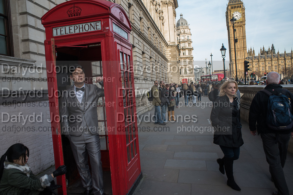 Chinese groom, Tourists, Westminster Sq. London13 March 2017