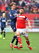 Patrick Bamford (9) of Leeds United battles for possession with Bailey Wright (5) of Bristol City during the EFL Sky Bet Championship match between Bristol City and Leeds United at Ashton Gate, Bristol, England on 9 March 2019.