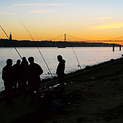 Fisherman at the Tagus River nearby Lisbon's downtown