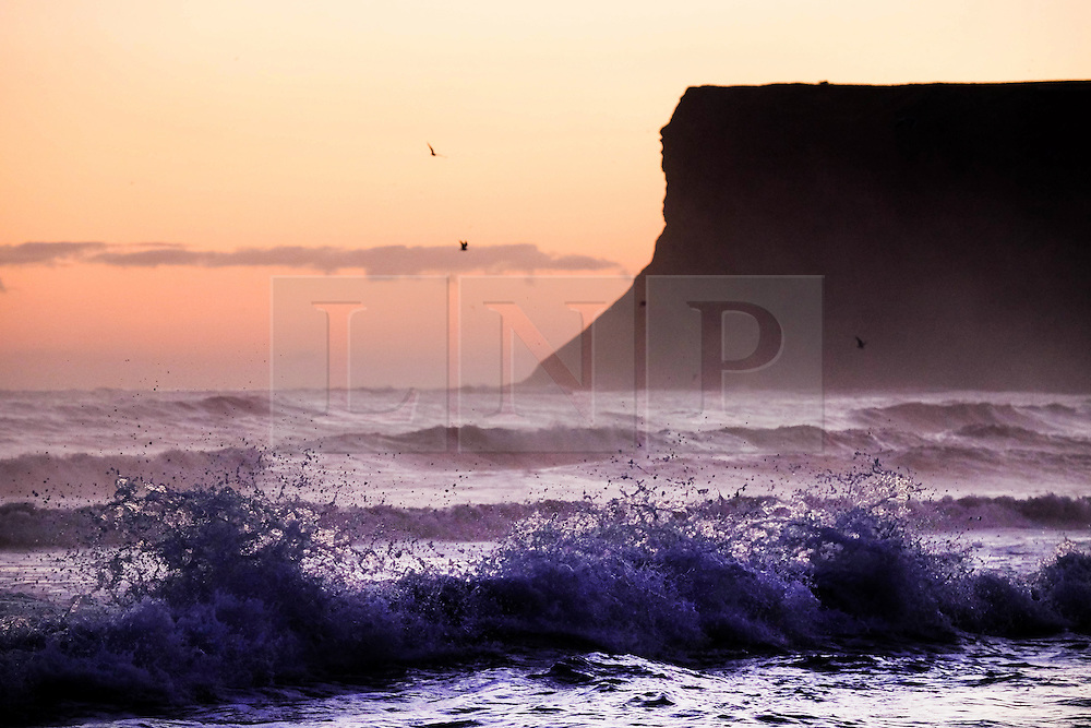 © Licensed to London News Pictures. <br /> 03/10/2016. <br /> Saltburn-by-the-Sea, UK.  <br /> <br /> A wave breaks against backwash on a cold October morning at Saltburn-by-the-Sea.<br /> <br /> Photo credit: Ian Forsyth/LNP