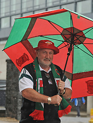 Trying to stay dry Joe Murphy from Kilmaine on his way to the All Ireland Semi Final against Kerry at Croke Park.<br /> Pic Conor McKeown