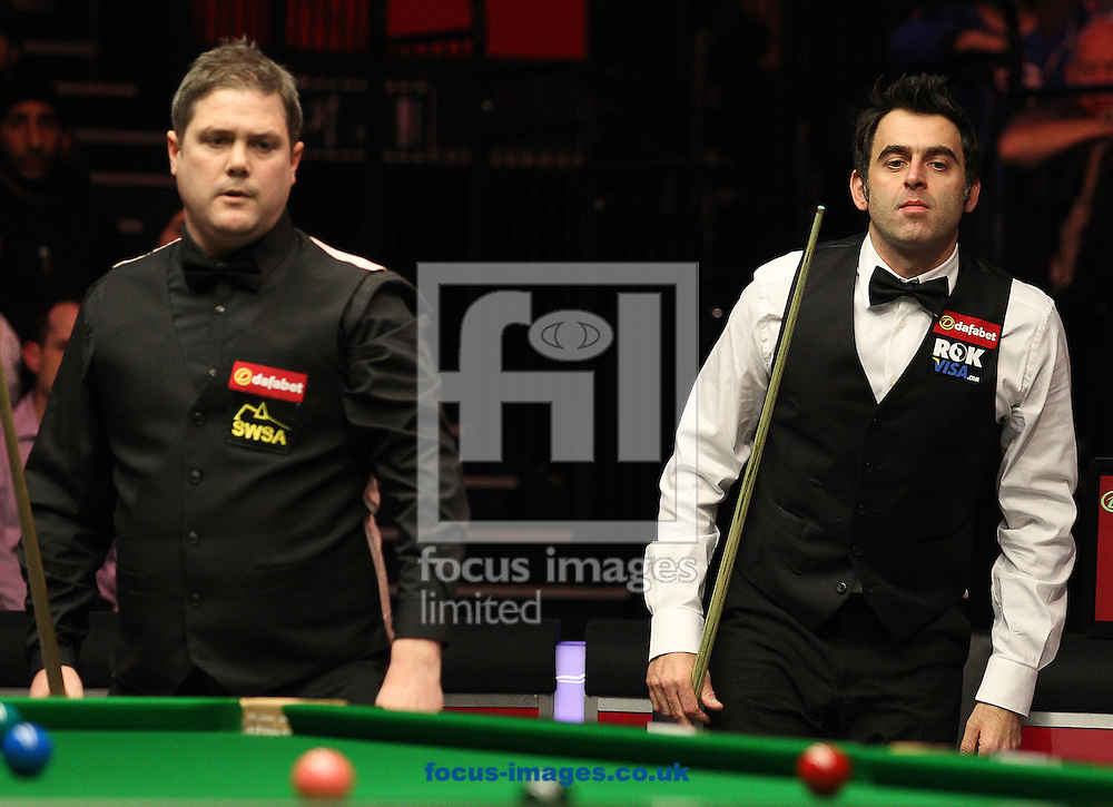 Picture by Paul Terry/Focus Images Ltd +44 7545 642257<br /> 14/01/2014<br /> Ronnie O' Sullivan ( R )  and Robert Mllkins during The Masters first round match at Alexandra Palace, London.