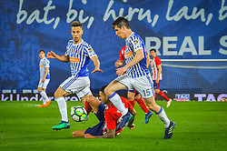April 19, 2018 - San Sebastian, Spain - Vitolo of Atletico Madrid duels for the ball with Sergio Canales and Aritz Elustondo of Real Sociedad during the Spanish league football match between Real Sociedad and Atletico Madrid at the Anoeta Stadium on 19 April 2018 in San Sebastian, Spain  (Credit Image: © Jose Ignacio Unanue/NurPhoto via ZUMA Press)