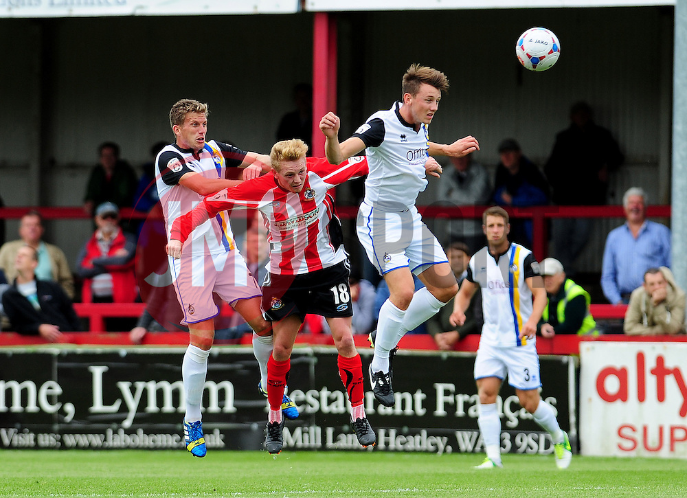 Bristol Rovers Ollie Clarke and Bristol Rovers Lee Mansell get the better of Altrincham's Sean Williams - Photo mandatory by-line: Neil Brookman - Mobile: 07966 386802 16/08/2014 - SPORT - FOOTBALL - Altrincham - J. Davidson Stadium - Altrincham v Bristol Rovers - Vanarama Conference Football