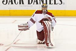 Mar 24, 2012; San Jose, CA, USA; Phoenix Coyotes goalie Mike Smith (41) warms up before the game against the San Jose Sharks at HP Pavilion. Mandatory Credit: Jason O. Watson-US PRESSWIRE