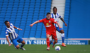 Blackburn Rovers player Craig Conway shields the ball from Brighton central midfielder Beram Kayal and Gaetan Bong during the Sky Bet Championship match between Brighton and Hove Albion and Blackburn Rovers at the American Express Community Stadium, Brighton and Hove, England on 22 August 2015. Photo by Bennett Dean.