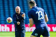 Scotland head coach passes the ball to Blair Kinghorn during the Scotland Rugby training run ahead of their match against France at BT Murrayfield Stadium, Edinburgh, Scotland on 23 August 2019.
