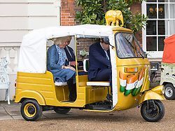 LONDON- UK - 26-MAR-2015: The Prince of Wales and The Duchess of Cornwall, Joint Presidents of Elephant Family, host a reception to launch the 'Travels to My Elephant' Rickshaw Race, Clarence House, London. During the event Their Royal Highnesses viewed the first two completed rickshaws taking part in the race. <br /> The rickshaw stalled several times prompting laughter with Prince Charles and Camilla<br /> Photograph by Ian Jones