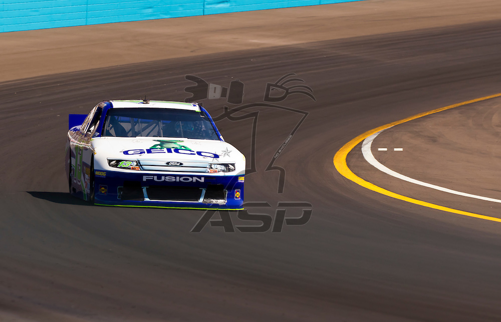 AVONDALE, AZ - MAR 03, 2012:  Casey Mears (13) brings his NASCAR Sprint Cup car through turn 4 during qualifying for the Subway Fresh Fit 500 race at the Phoenix International Raceway in Avondale, AZ.