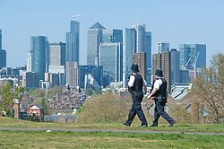 ©Licensed to London News Pictures 14/04/2020  <br /> Greenwich, UK. Two police officers on patrol. Sunny weather in Greenwich park, Greenwich, London as people get out of the house from coronavirus lockdown to exercise. Photo credit:Grant Falvey/LNP