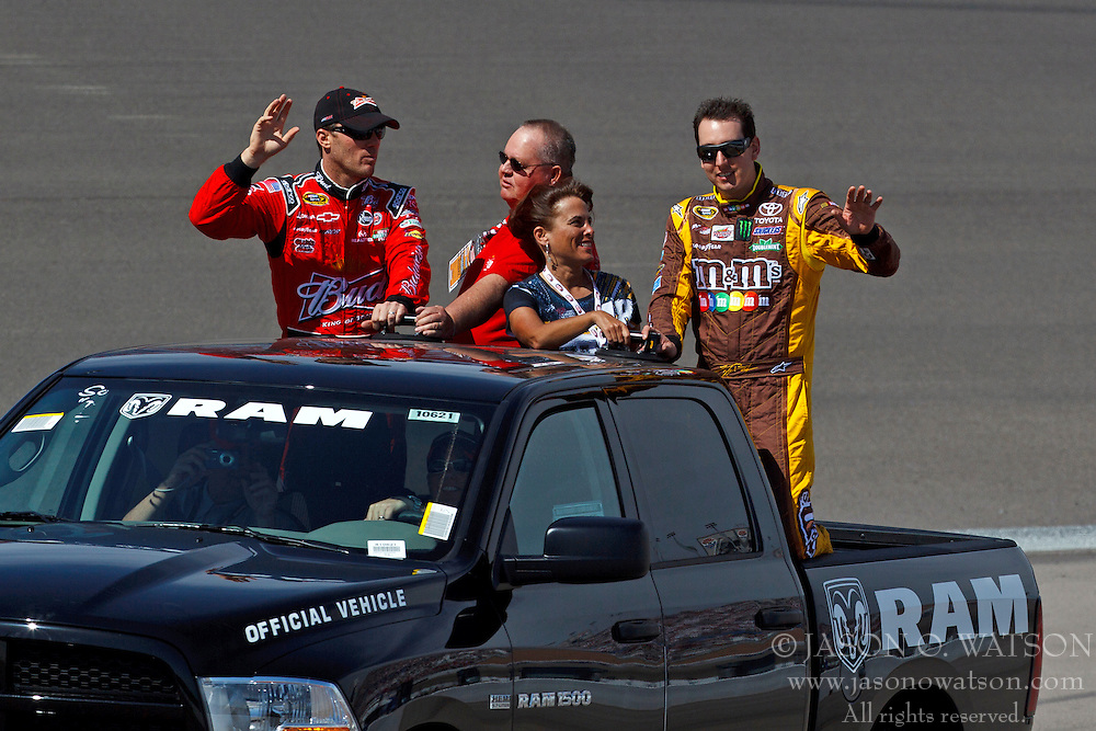 Mar 11, 2012; Las Vegas, NV, USA;  Sprint Cup Series driver Kevin Harvick (left) and driver Kyle Busch (right) during introductions before the Kobalt Tools 400 at Las Vegas Motor Speedway. Mandatory Credit: Jason O. Watson-US PRESSWIRE
