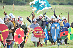 © Licensed to London News Pictures. 13/10/2018<br /> BATTLE, UK.<br /> Saxon warriors at the battle.<br /> English Heritage Battle of Hastings re-enactment at Battle Abbey,Battle, on the 1066 battle field.<br /> Photo credit: Grant Falvey/LNP