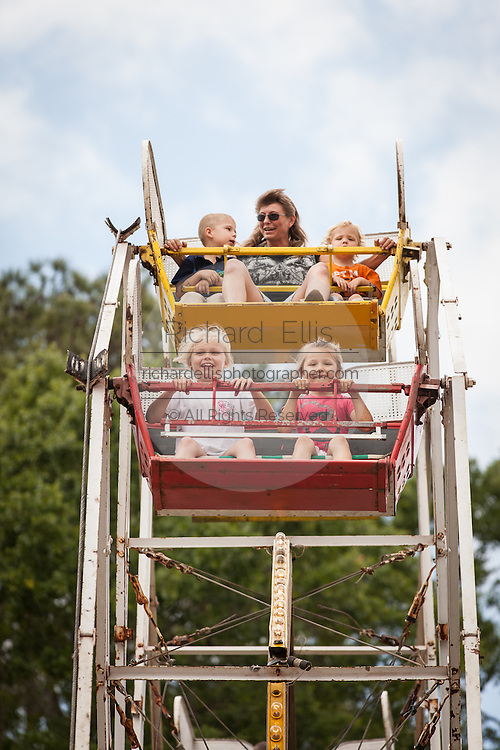 Children ride an old fashion ferris wheel at the World Grits Festival April 14, 2012 in St. George, SC. The festival celebrates the southern love for the sticky corn porridge
