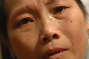 "Ms. Mee Moua Vang, pleads for help, near Vang Vieng, Laos, July 4, 2006.  Her message  to the world, ""My husband and two older daughters were killed by the communist while foraging for food.  My daughter Blee was attacked by the communist where her guts were sticking out and I was unable to help her so she died.  I miss her very much.  I am desperately suffering here with no help.  I ask you to come in and save us.  Bring us food.""..**EXCLUSIVE, no tabloids without permission**"