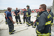 Milpitas Fire Department firefighters work through search and rescue drills at a private commericial location in Milpitas, California, on May 8, 2016. (Stan Olszewski/SOSKIphoto)