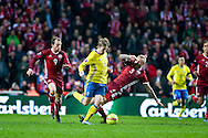 17.11.2015. Copenhagen, Denmark. <br /> Emil Forsberg (C) of Sweden fights for the ball with Riza Durmisi (R) of Denmark during their UEFA EURO 2016 play-off second leg round match at the Telia Parken Stadium. <br /> Photo: © Ricardo Ramirez.