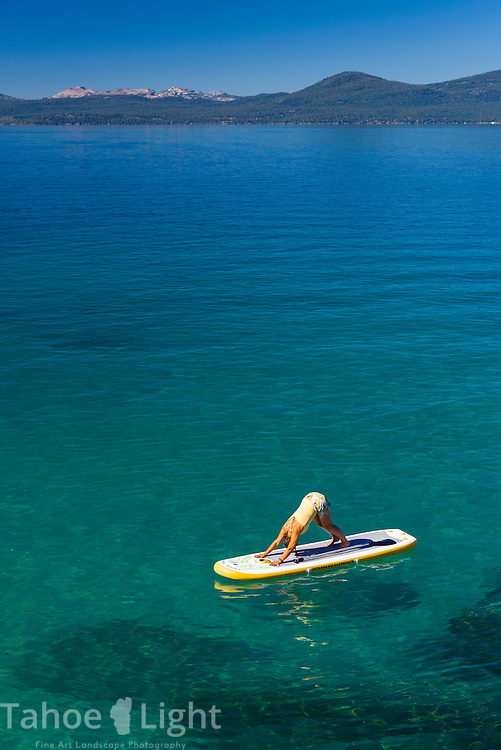 Stand up Paddle Board yoga near Sand Harbor on Lake Tahoe