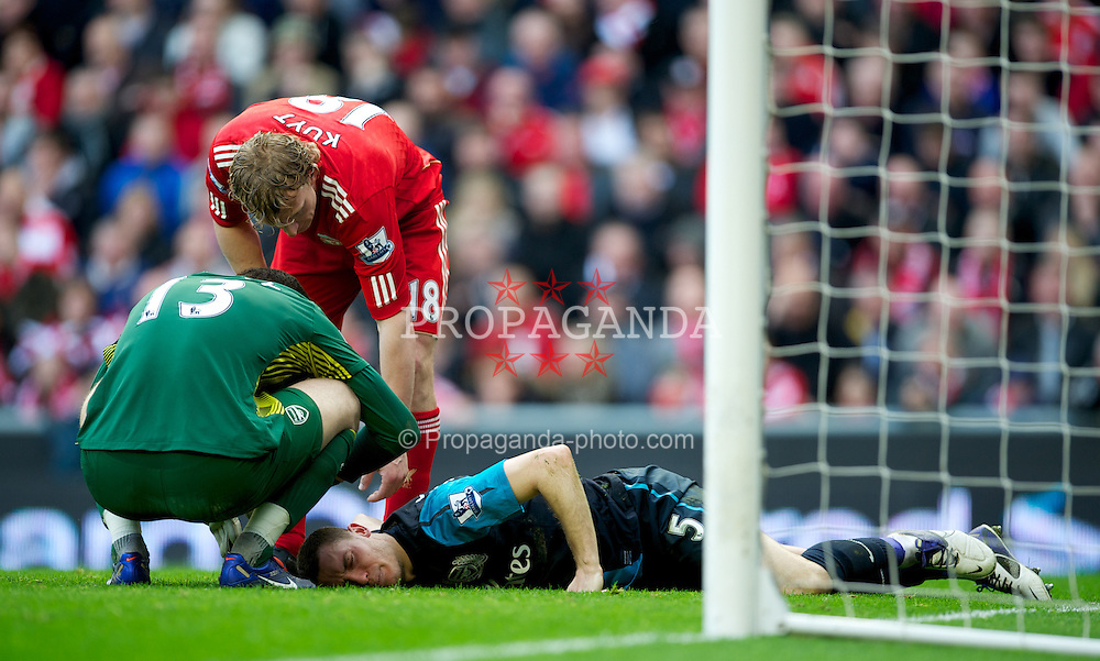 LIVERPOOL, ENGLAND - Saturday, March 3, 2012: Arsenal's Thomas Vermaelen lies injured during the Premiership match against Liverpool at Anfield. (Pic by David Rawcliffe/Propaganda)