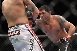 August 27, 2011; Rio De Janiero, Brazil; Brendan Schaub (white trunks) and Minotauro Nogueira (black trunks) during their bout at UFC 134 in Rio De Janiero.