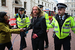 © Licensed to London News Pictures. 03/10/2019. London, UK. The scene at the Treasury in Westminster which has been sprayed in red paint by Extinction Rebellion activists . The stunt, which partly went wrong, was intended to cover the building in red dye looking like blood. Photo credit: Rob Pinney/LNP