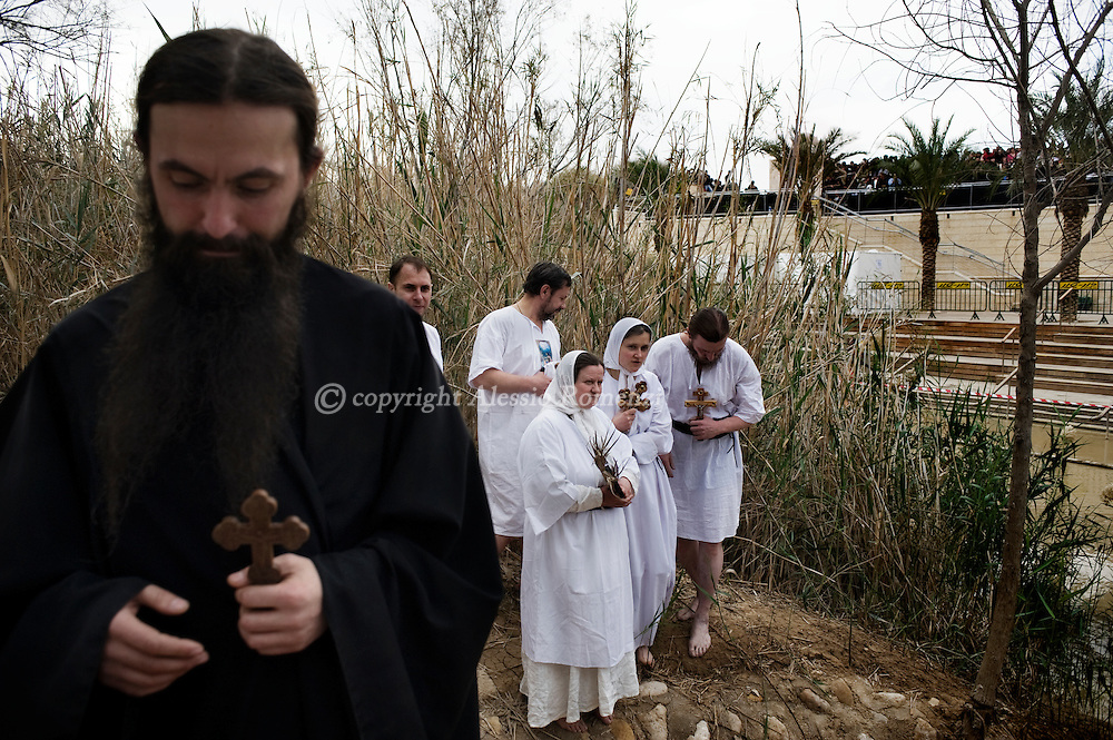 """JORDAN, BETHANY : Eastern European Christian Orthodox pilgrims stand close to Jordan river in Bethany on January 18, 2011, believed to be the biblical """"Bethany-beyond-the-Jordan"""", where John the Baptist lived and Jesus was baptized. ALESSIO ROMENZI"""