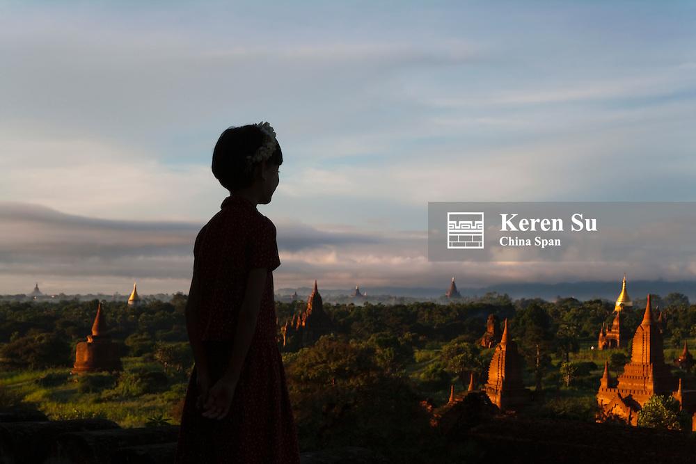 Girl with temples in Bagan, Myanmar