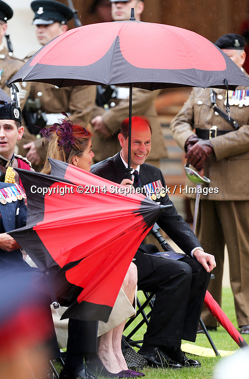 Image licensed to i-Images Picture Agency. 28/06/2014. London, United Kingdom. The Earl of Wessex shelters from the rain  at the Solemn Drumhead Service at the Royal Hospital Chelsea, London. The service was to commemorate those who volunteered to serve in the First World War on the Centenary of the assassination of Archduke Franz Ferdinand.  Picture by Stephen Lock / i-Images