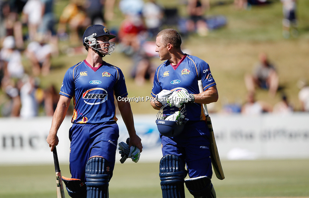 Volts Neil Broom and Craig Cumming leave the field after winning the Twenty20 Cricket - HRV Cup, Otago Volts v Wellington Firebirds, Saturday 31 December 2011, Queenstown Events Centre, Queenstown, New Zealand. Photo: Michael Thomas/photosport.co.nz
