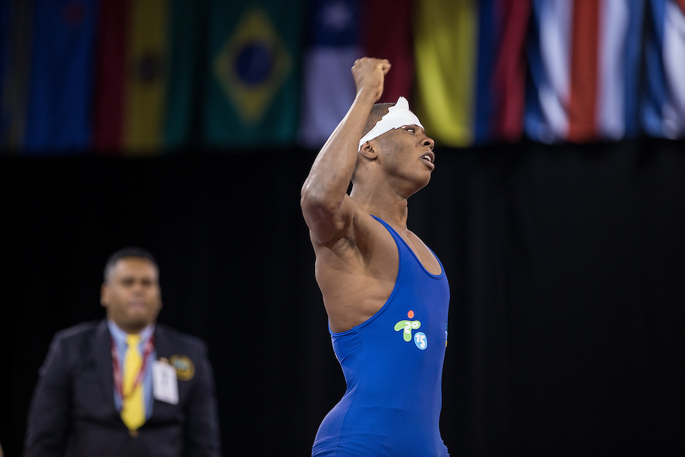 Gold medalist Andres Montano of Ecuador celebrates his win over Ali Soto of Mexico in the 59kg weight class of the men's greco-roman wrestling at the 2015 Pan American Games in Toronto, Canada, July 15,  2015.  AFP PHOTO/GEOFF ROBINS