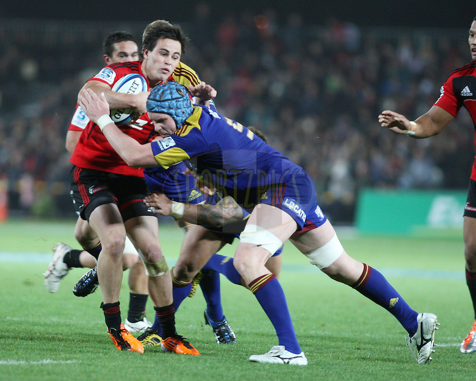 Zac Guildford tries to break the defence.Crusaders v Highlanders, Investec Super Rugby, Trafalgar Park, Nelson. 23 April 2011. Photo: Evan Barnes/photosport.co.nz